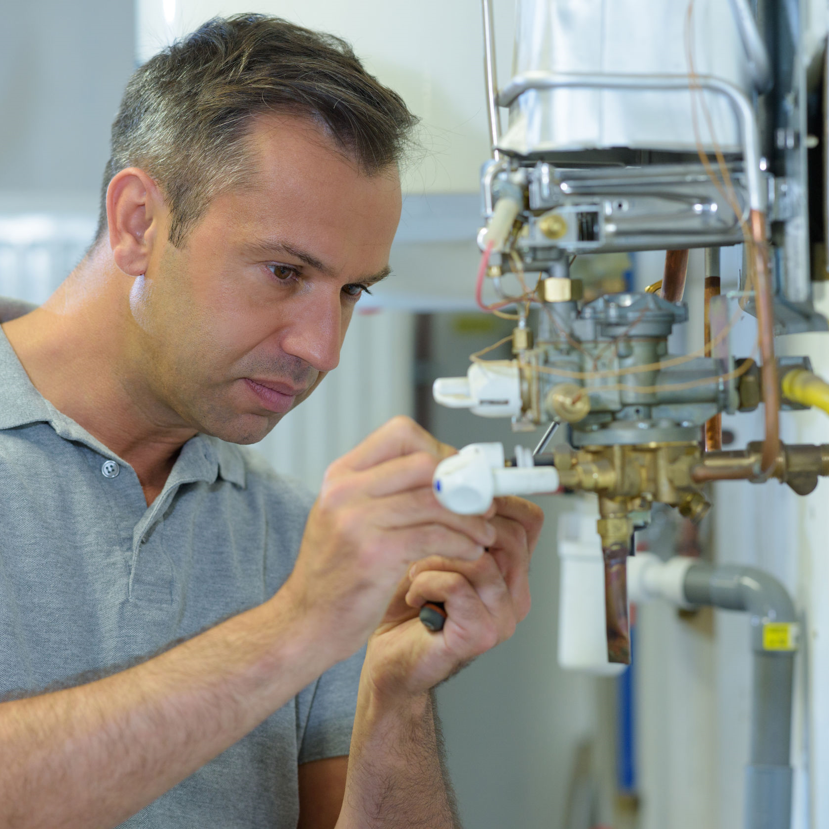 Technician working on a hot surface igniter